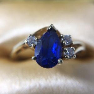 14k yellow gold pear blue topaz & CZ accent ring